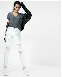 de4cf05ca2d4a Women's White Ripped Jeans by Express | Women's Fashion | Lookastic.com