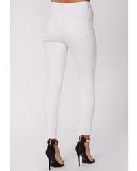 c0203fb56b9 ... Missguided Edie Ripped Knee Raw Hem Ankle Grazer Skinny Jeans White ...