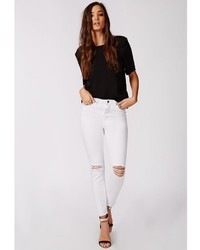 6b39271c3e2 ... Missguided Edie Ripped Knee Raw Hem Ankle Grazer Skinny Jeans White ...