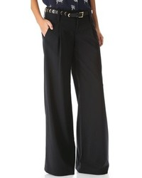 Opt for dark brown leather pumps and wide leg pants for a sleek elegant look.