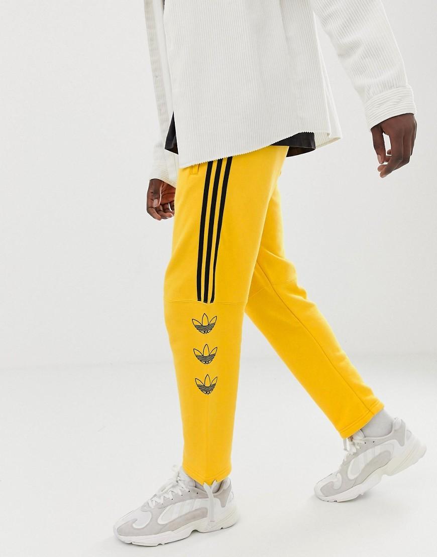 estoy de acuerdo con Frustración preocupación  adidas Originals Trefoil Stripe Joggers Dv3149 Yellow, $60 | Asos |  Lookastic