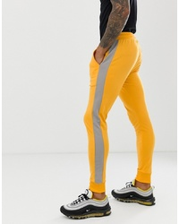 ASOS DESIGN Skinny Joggers In Poly Tricot With In Yellow