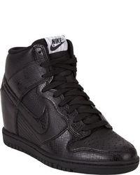 Zapatillas con cuña de cuero negras