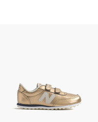 Zapatillas de cuero doradas de New Balance