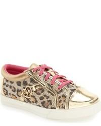 Zapatillas doradas de Jessica Simpson