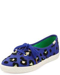 Zapatillas slip-on de leopardo azul marino de Kate Spade