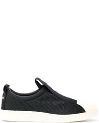 Zapatillas slip-on de rayas horizontales negras de adidas