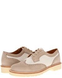 Zapatos brogue de cuero en beige