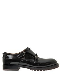 Zapatos con doble hebilla de cuero negros de Valentino