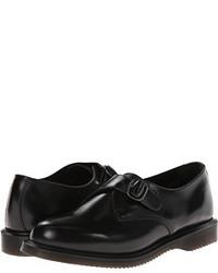 Zapatos con doble hebilla