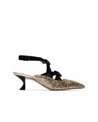 Zapatos de tacón de cuero en negro y dorado de Miu Miu