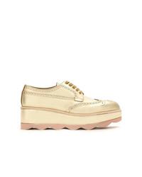 Zapatos oxford de cuero dorados de Prada